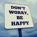 Don t worry be happy retro effect faded and toned image of a billboard Royalty Free Stock Photo