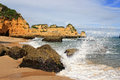 Dona ana beach lagos portugal in with waves splashing on rocks algarve Royalty Free Stock Image