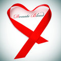 Donate blood the sentence and a red ribbon forming a heart Stock Photography