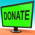 Donate computer shows charity donating and fundraising showing Stock Image