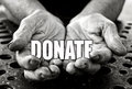 Donate concept in the old female hands Royalty Free Stock Photos