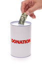 Donation box collection with hand donating money concept for charity and relief work help and support Stock Images