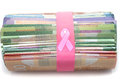 Donation money for cancer treatment with pink ribbon over rubber band Stock Photo