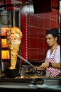 A doner kebab chef cuts meat from his rotisserie at a roadside cafe in istanbul s sultan ahmet district Royalty Free Stock Images