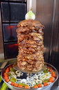 Doner kebab roasted on rotating spit food background texture Stock Images
