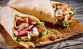 Doner kebab in a tortilla wrap Royalty Free Stock Photo