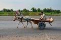 Donkey cart driver and motorcycle on pakistan highway punjab september a man looks while sitting his two wheeled driving down the Stock Images