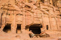 Donkey and royal tombs in nabatean city of petra jordan middle east Royalty Free Stock Images