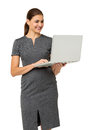 Donna di affari felice using laptop Immagine Stock
