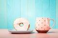 Donut and dish with pink mug Royalty Free Stock Photo