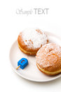 Donut with dreidel on plate Royalty Free Stock Photos