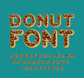 Donut font. pie alphabet. Baked in oil letters. Chocolate icing