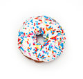 Donut rainbow sprinkled on a white background Stock Photo