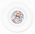Donut sprinkled on a white plate Royalty Free Stock Photo