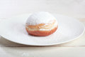 Donut or sufganiya hanukkah doughnut with jam and caster sugar Stock Photos