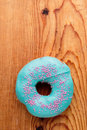 Donut with turquoise frosting Royalty Free Stock Photo