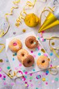 Donuts for carnival and party. Donuts with streamers and confetti Royalty Free Stock Photo