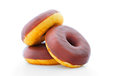 Donuts with chocolate icing on a white background Royalty Free Stock Image