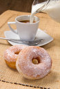 Donuts with coffee Stock Images