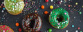 Donuts and colorful sprinkles Royalty Free Stock Photo