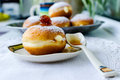 Donuts with cream sprinkled with powdered sugar Stock Image