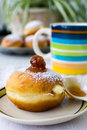 Donuts with cream sprinkled with powdered sugar and cup buttermilk Stock Images