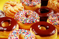 Donuts with icing and sprinkles Royalty Free Stock Photo