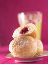Donuts on a plate with a glas in the background Royalty Free Stock Photos