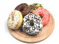 Donuts on wooden plate Stock Photos