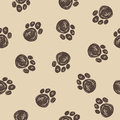 Doodle dog tracks seamless pattern background. Royalty Free Stock Photo