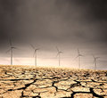 Doomed windfarm in a barren cracked desert Royalty Free Stock Images