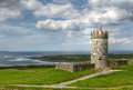 Doonagore castle with cloudy sky on the coastal road to famous moher cliffs clare county ireland Royalty Free Stock Photos