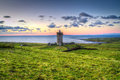 Doonagore castle at sunset in Co. Clare Stock Photo