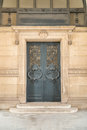 Door architectural exteriors details of the Louvre museum Royalty Free Stock Photo