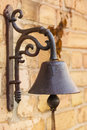 A door bell with a strap bricks as background Royalty Free Stock Images
