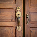 Door brass handles and wooden close up Stock Images