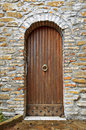 Door on bricks wall arch wooden Royalty Free Stock Photos