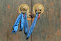 Door of buddhist temple lion heads and blue ribbon on a Royalty Free Stock Photography
