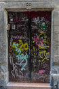 Door covered with graffiti in the old town of barcelona catalonia spain Stock Photo