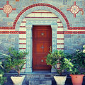 Door entrance and flower pots in beautiful greek monastery(Greec Royalty Free Stock Photo