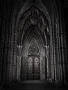 Door in a fantasy cathedral ornamented dark Stock Images