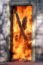 Door in flames Stock Photos