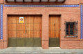 Door and garage brick facade with window Stock Photos