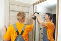 Door installation workers two male carpenters at internal Royalty Free Stock Photos