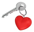 Door key and heart shaped keyring love relationship wedding valentines day concept nickel with red isolated on white background Royalty Free Stock Photography