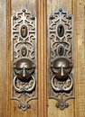 Door knockers with ornamental escutcheons in lisbon portugal Royalty Free Stock Photography