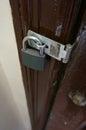 Door lock metal protecting property behind wooden Royalty Free Stock Photo