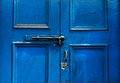 Door locker handle on a blue wooden Royalty Free Stock Photos