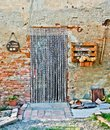 Door of the old farm with ancient tools used in past years in ag Royalty Free Stock Photo