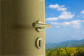 The door open to mountain view in blue sky Royalty Free Stock Photo